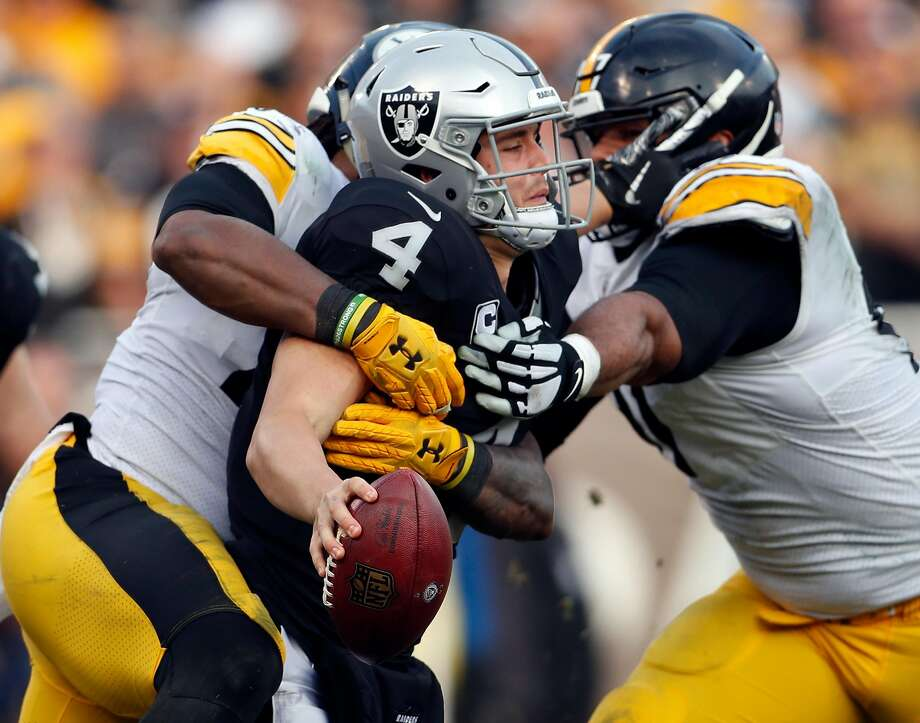 Oakland Raiders' Derek Carr is sacked in 3rd quarter by Pittsburgh Steelers during Raiders' 24-21 win in NFL game at Oakland Coliseum in Oakland, Calif., on Sunday, December 9, 2018. The Raiders will be underdogs for many games next season, thanks to an unfavorable schedule — the worst in the NFL, according the Strength of Schedule rankings. Photo: Scott Strazzante / The Chronicle 2018