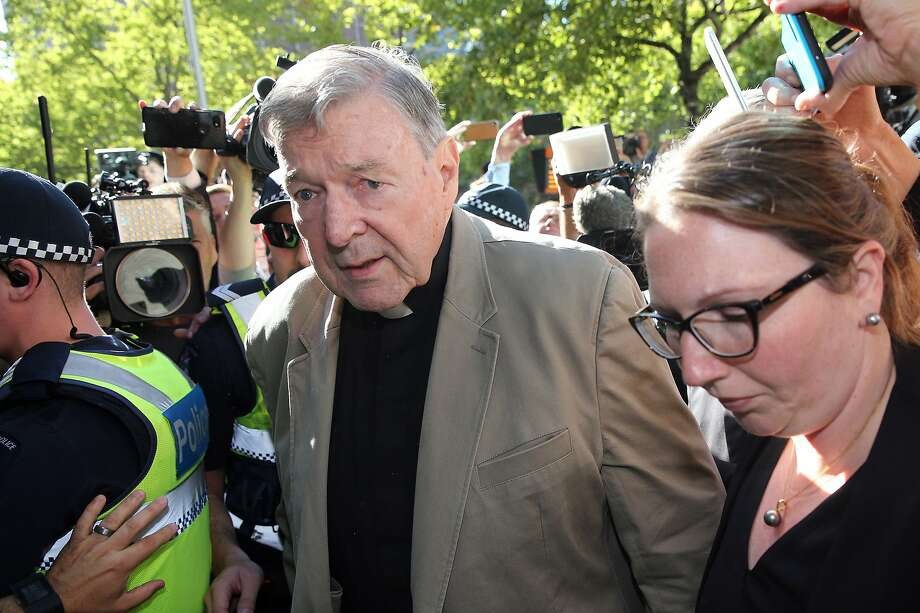 Cardinal George Pell arrives in a Melbourne court. Pell, 77, faces up to 50 years in prison. Photo: Con Chronis / AFP / Getty Images
