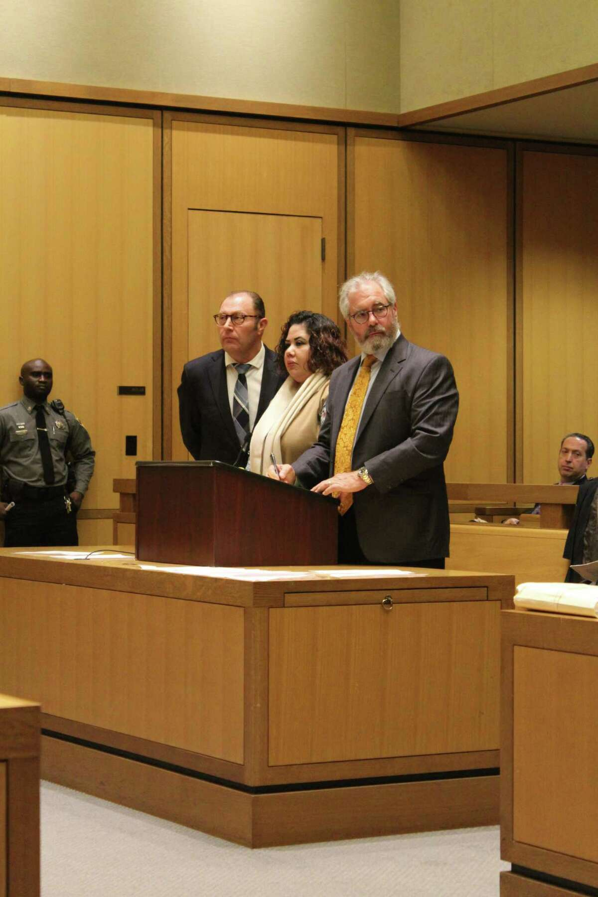 Nydia Carrillo-Maldonado, center, pleaded guilty to charges of first-degree manslaughter and risk of injury to a minor in Stamford Superior Court in December.