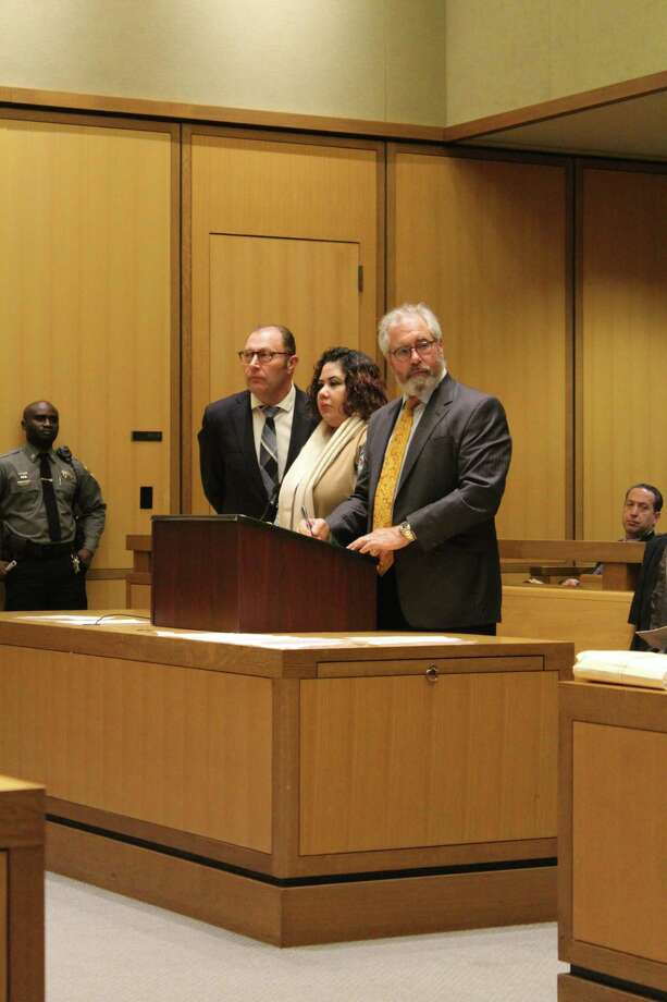 Nydia Carrillo-Maldonado, center, pleaded guilty to charges of first-degree manslaughter and risk of injury to a minor in Stamford Superior Court in December. Photo: Ignacio Laguarda / Hearst Connecticut Media / Stamford Advocate