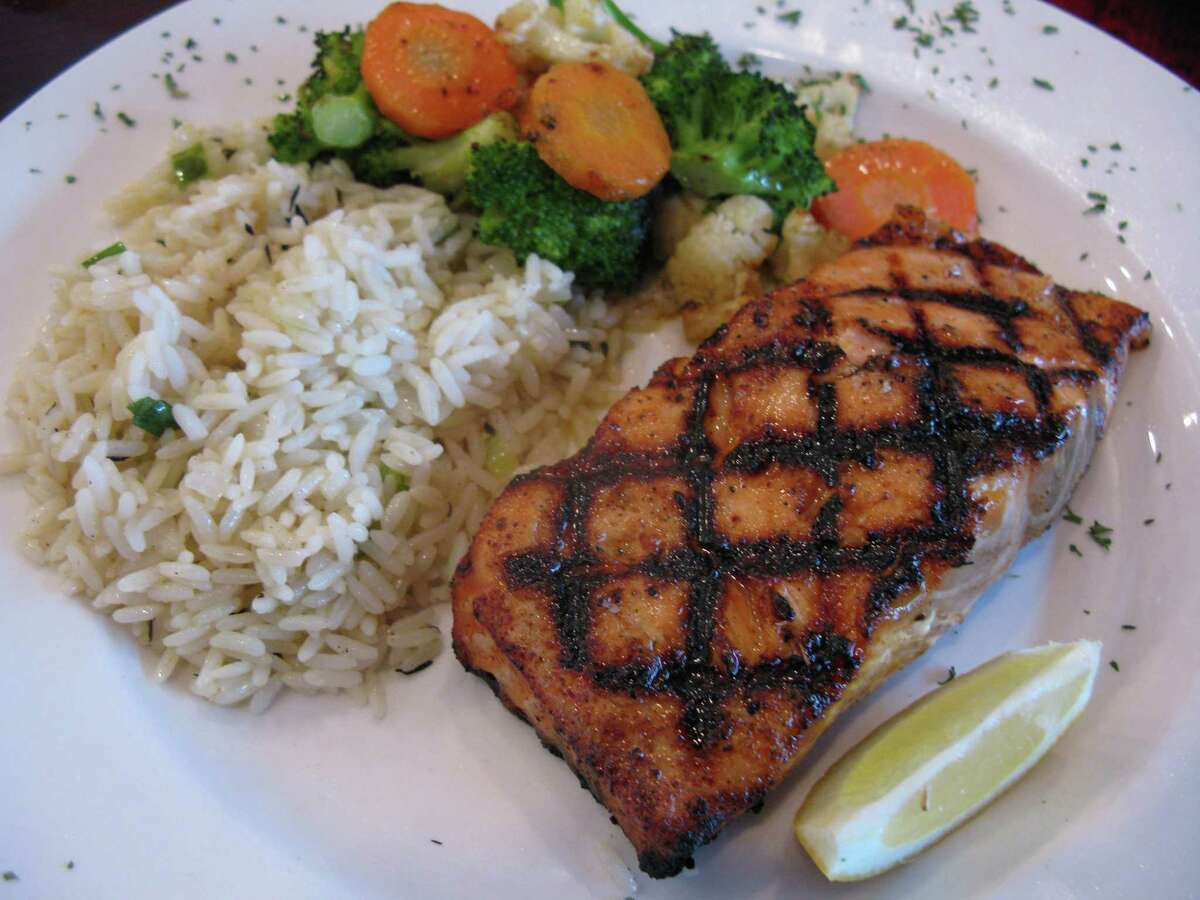 An order of River City Salmon comes grilled with rice pilaf and vegetables at River City Seafood & Grill.