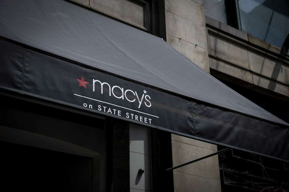 """FILE - Macy's signage is displayed outside a department store in downtown Chicago. A single tweet complaining about novelty plates that measured food portions by """"skinny jeans,"""" """"favorite jeans"""" and """"mom jeans"""" prompted Macy's to drop the product only hours later.  Photo: Bloomberg Photo By Christopher Dilts. / © 2018 Bloomberg Finance LP"""