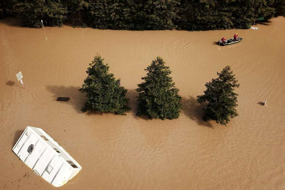 A Forestville Fire Department boat searches along River Road and Maribel Road on Wednesday, Feb. 27, 2019, in Forestville, Calif. Photo: Santiago Mejia / The Chronicle
