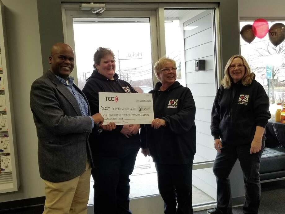 """Round Room LLC, the nation's largest Verizon Authorized Wireless Retailer, opened their newest TCC location in Torrington, located at 1875 E. Main St. On Feb. 8, TCC hosted a grand opening event for the Torrington community and donated $1,500 to For the Love of Jack, which acts as a """"vocal advocate for sick, injured and hungry animals and their owners as well as a provider of food, medical care and other appropriate forms of assistance for those who need our help."""" Photo: Contributed Photo"""