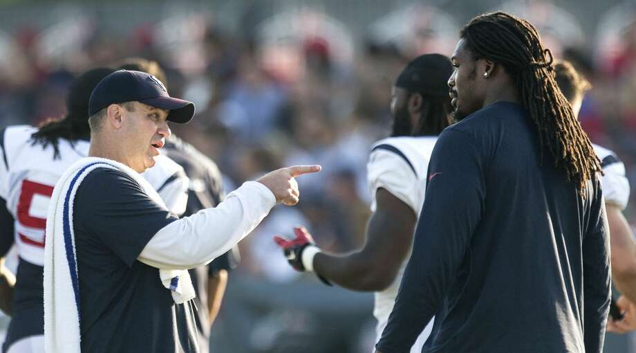 PHOTOS: Contract situations for each Texans player  Houston Texans head coach Bill O'Brien talks to outside linebacker Jadeveon Clowney during Texans training camp at the Methodist Training Center Tuesday, Aug. 11, 2015, in Houston.  ( Brett Coomer / Houston Chronicle ) >>>Browse through the gallery for a look at contract situations for each Texans player during the offseason ...  Photo: Brett Coomer/Houston Chronicle
