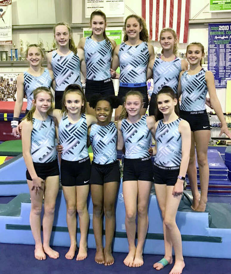 A group of 11 gymnasts from Mid Illinois Gymnastics in Godfrey have qualified for their upcoming state gymnastics meets. The Levels 6, 9 and 10 state meet is set for March 15-17 in DeKalb. The Levels 7 and8 state meet is March 29-31 in St. Charles, Ill. Back row from left: Olivia Swagler (Level 6), Madison Honke (Level 7), Jaylee Evans (Level 6), Caroline Cain (Level 6) and Allison Wooden (Level 6). Front: Sammi Hentrich (Level 6), Ruby Pruitt (Level 6) Sevasti Bionolis (Level 8), Paige Mouser (Level 8), Sophie Rose (Level 6) and Alison Jennings (Level 8). Photo: Submitted Photo