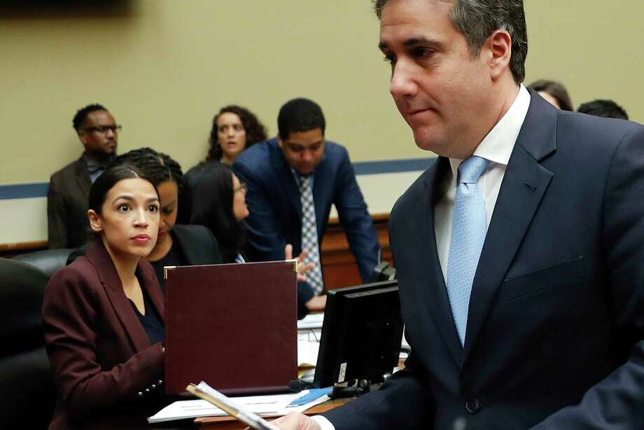 Michael Cohen, right, President Donald Trump's former lawyer, walks past committee member Rep. Alexandria Ocasio-Cortez, D-N.Y., center, during a break in Cohen's testimony before the House Oversight and Reform Committee on Capitol Hill in Washington, Wednesday, Feb. 27, 2019. Photo: Pablo Martinez Monsivais, AP / Copyright 2019 The Associated Press. All rights reserved