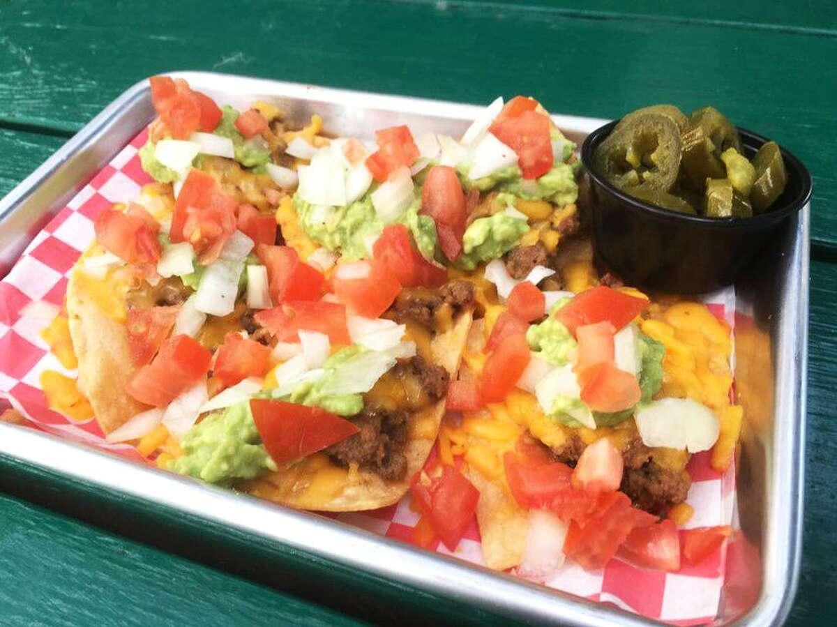 Nachos rancheros at Ruben's Backyard are made with picadillo, cheese, guacamole, onions and tomato.