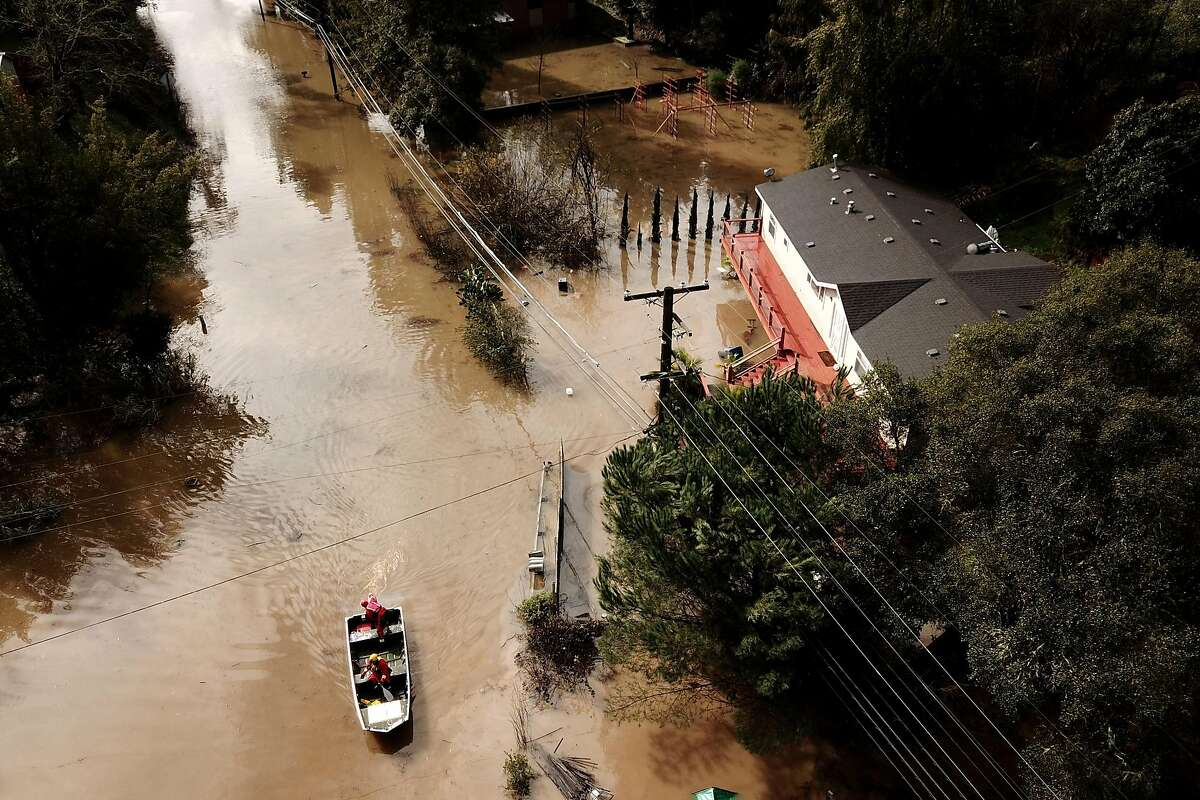 A Forestville Fire Department boat searches along Maribel Road and River Road on Wednesday, Feb. 27, 2019, in Forestville, Calif.