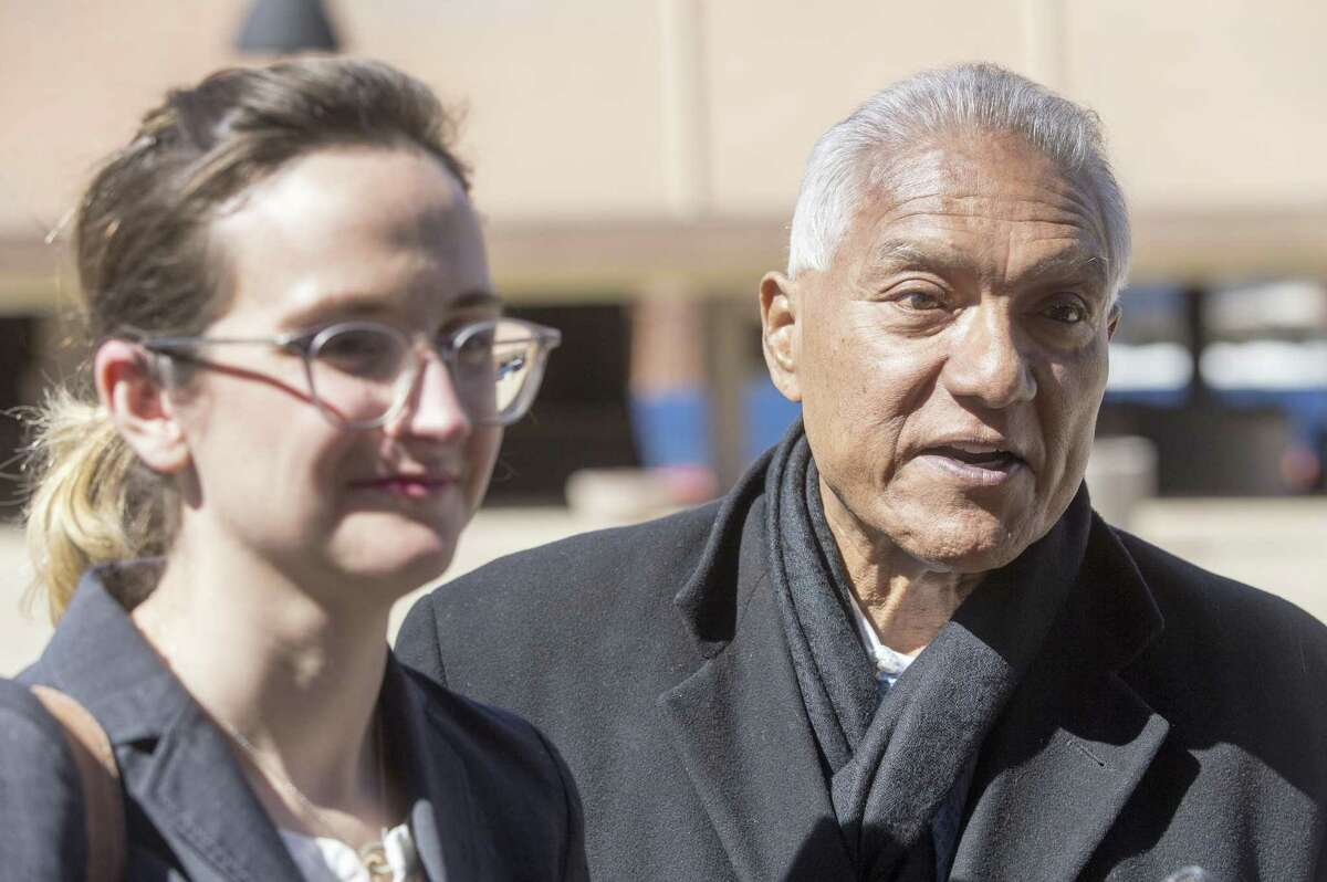 Luis Vera Jr., right, the League of United Latin American Citizens' national general counsel, speaks outside the John H. Wood Federal Courthouse last week after a hearing about the state's initiative to purge tens of thousands of Texans from voter rolls who officials claim are not U.S. citizens. At left is LULAC's attorney in the case, Danielle Lang, of the Washington, D.C.-based Campaign Legal Center.