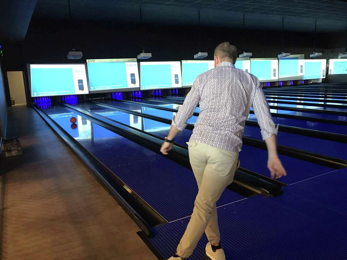 EVO Entertainment Group CEO Mitchell Roberts bowls a frame at EVO's new Schertz movie multiplex. The theater features 16 regulation lanes.