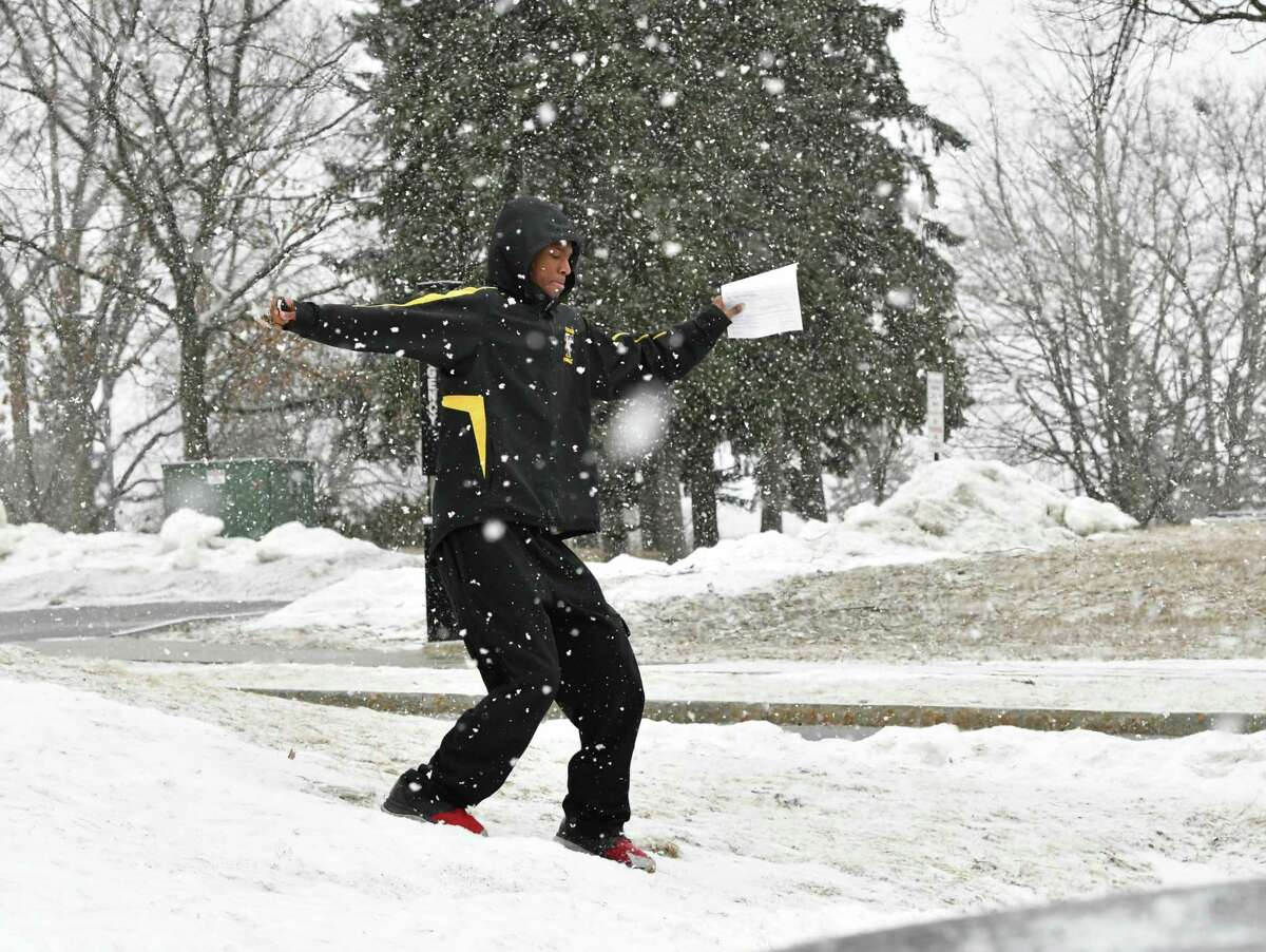 A pedestrian almost slips coming down a small hill during a snow fall on Wednesday, Feb. 27, 2019 in Troy, N.Y. (Lori Van Buren/Times Union)
