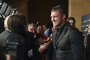 """IMAGE DISTRIBUTED FOR RUN THE RACE, LLC - Tim Tebow is interviewed at the """"Run the Race"""" world premiere held at the Egyptian Theatre on Monday, Feb. 11, 2019, in Los Angeles. (Photo by Phil McCarten/Invision for RUN THE RACE, LLC/AP Images)"""