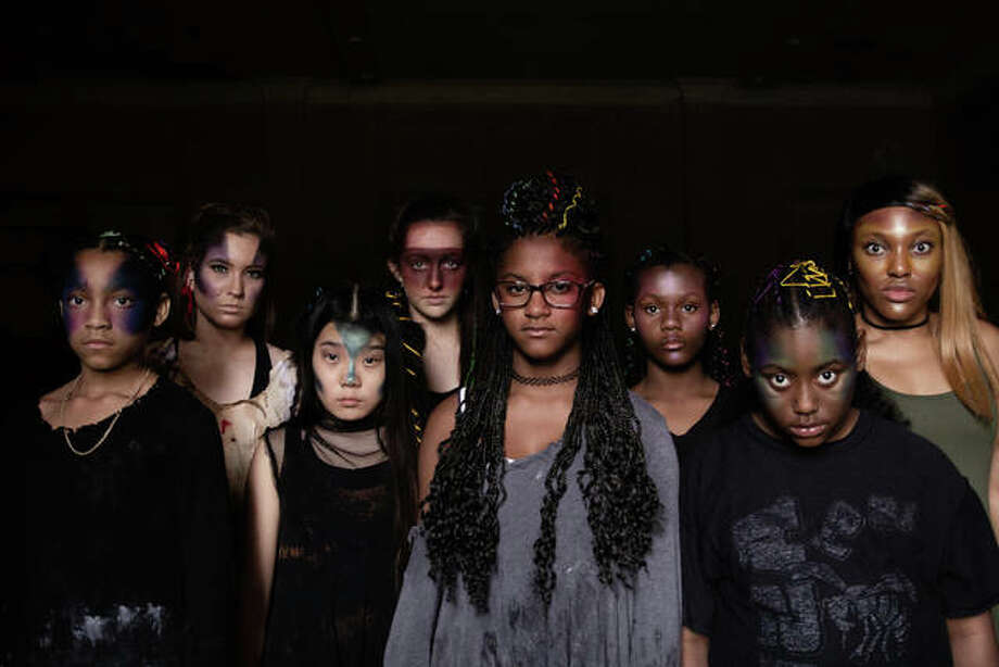 """Female dancers in the music video, """"ReBeL,"""" including Yadan Shourd (front row, second from left). Photo: For The Telegraph"""