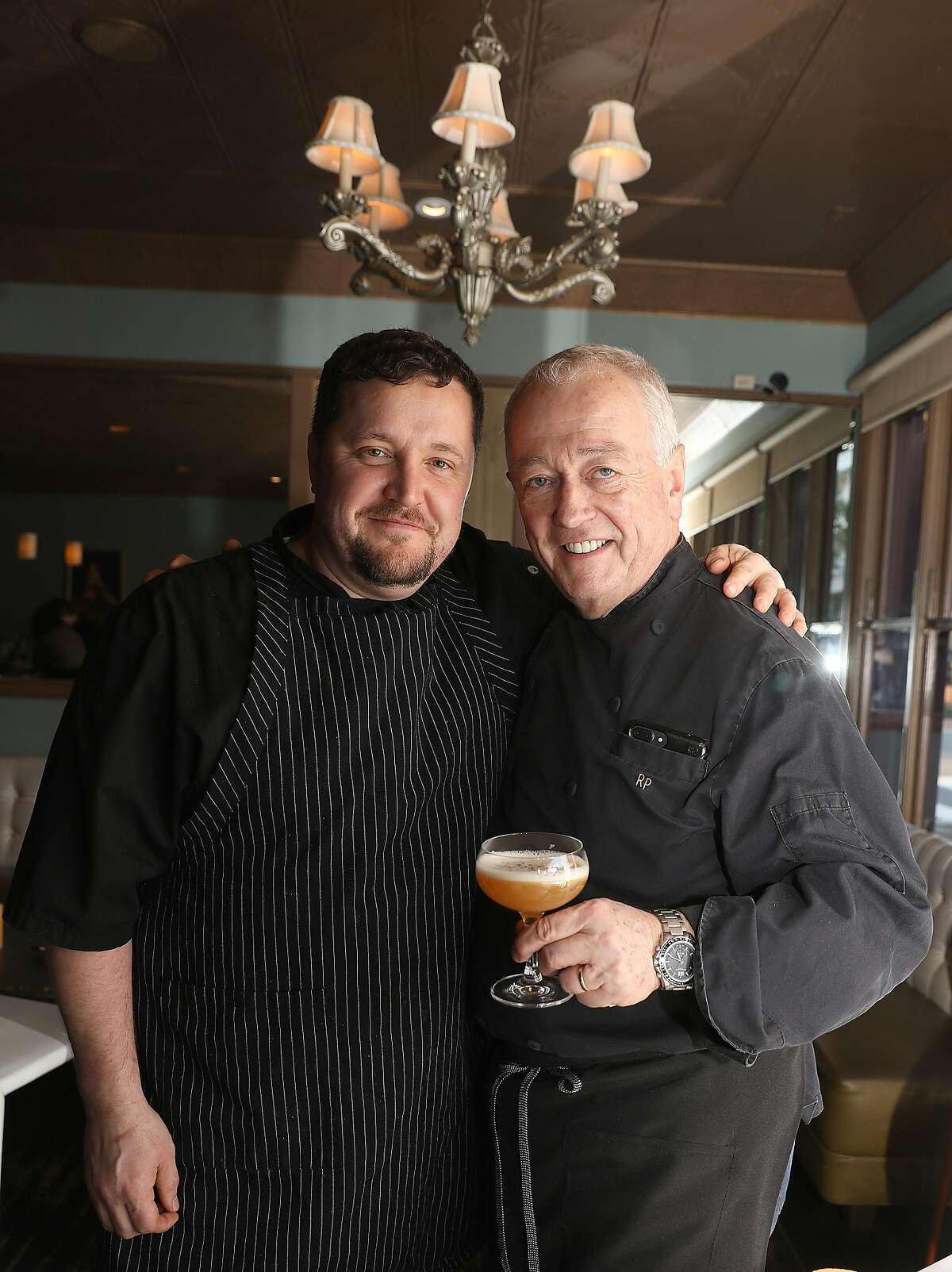 Lead lounge chef Matthew Templeton (left) and chef proprietaire Roland Passot pose at La Folie's lounge on Thursday, Feb. 21, 2019, in San Francisco, Calif.