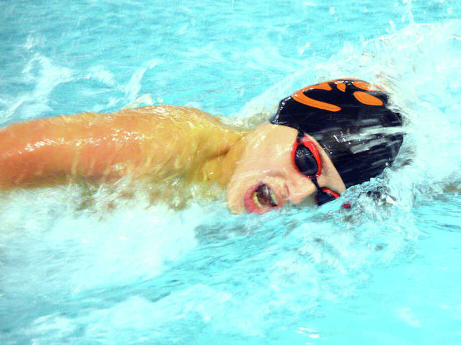 Edwardsville freshman Evan Grinter competes in the 200-yard freestyle during the Edwardsville Sectional on Feb. 16 at Chuck Fruit Aquatic Center. Photo: Scott Marion/Intelligencer