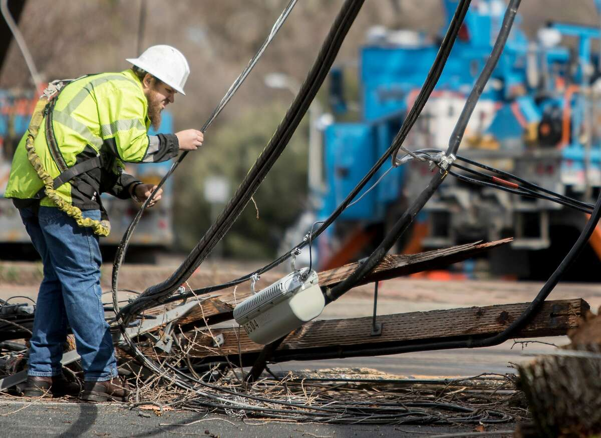 PG&E crews investigate a downed telephone pole along Ygnacio Valley Road near Civic Drive in Walnut Creek, Calif. Wednesday, Feb. 27, 2019 after a large tree fell across Ygnacio Valley Road due to heavy overnight winds and rain, blocking traffic in both directions and knocking out power to the area.