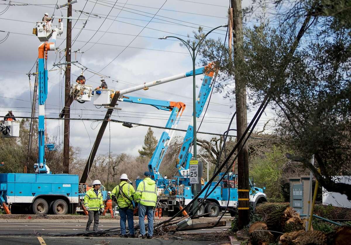 PG&E crews investigate a downed telephone pole along Ygnacio Valley Road near Civic Drive in Walnut Creek, Calif. Wednesday, Feb. 27, 2019.