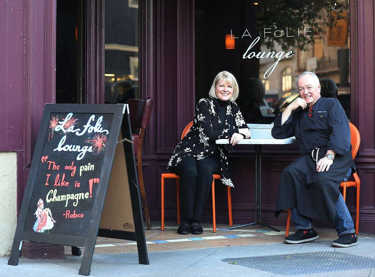 Jamie and Roland Passot pose in front of La Folie's lounge on Thursday, Feb. 21, 2019, in San Francisco, Calif.