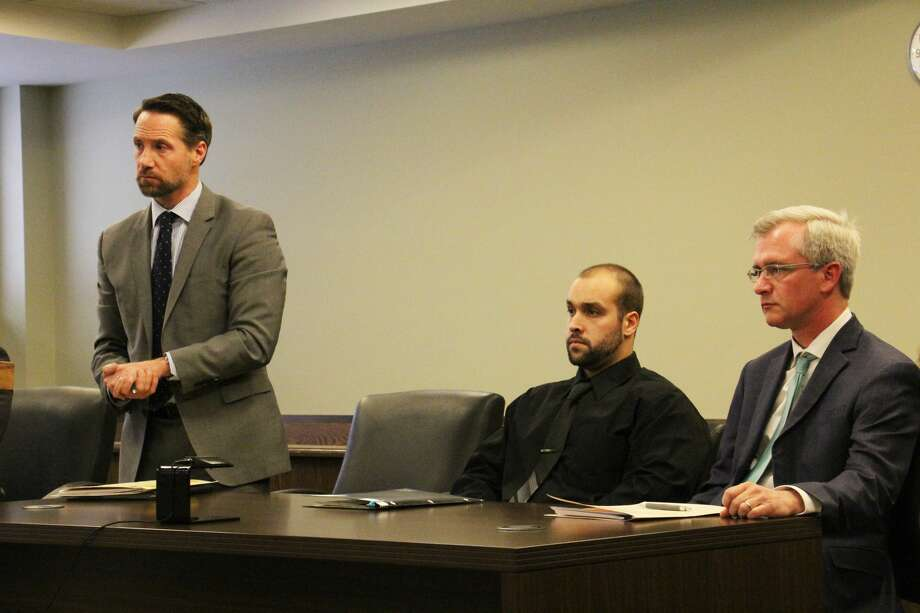 Left, defense attorney Matthew L. Norwood addresses Huron County District Judge David B. Herrington during a probable cause conference Wednesday. Norwood and Christopher McGrath, right, are representing Michigan State Police Trooper Adam S. Mullin, who is accused of assaulting a female trooper while on duty in Bad Axe. Mullin is scheduled to appear in court next on April 5 for a preliminary examination. Photo: Bradley Massman/Huron Daily Tribune