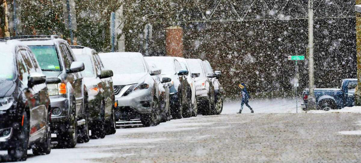 Click through the photos of the Capital Region winter weather in 2018-19. A woman makes her way along Lodge Street as large snow flakes fall on Wednesday, Feb. 27, 2019, in Albany, N.Y. (Paul Buckowski/Times Union)