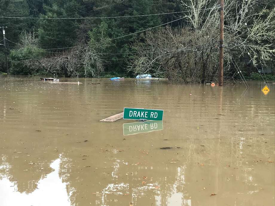 Flood damage along Drake Road in Guerneville on Wednesday. The water was full of debris, garbage and neighbors' belongings. Photo: Peter Fimrite / The Chronicle