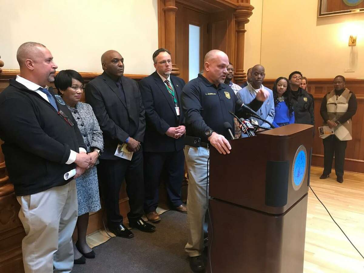 New Haven police Lt. Karl Jacobson speaks at a City Hall.