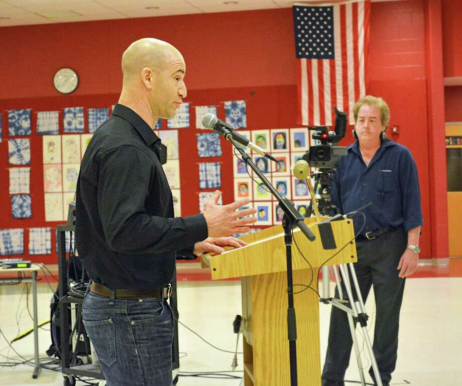 The Haddam-Killingworth Board of Education rejected a motion to donate the 155 acres of Swan Lake trails to the Haddam Land Trust. Here, Haddam resident Ross Hanson speaks Tuesday night at the middle school. Photo: Cassandra Day / Hearst Connecticut Media