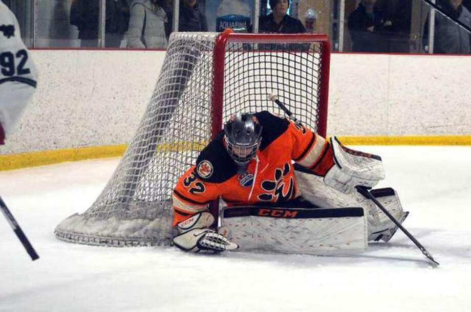 Edwardsville goalie Mason Young covers up the puck during the second period of a Feb. 2 game against Marquette at the Brentwood Ice Rink. Photo: Scott Marion/Intelligencer