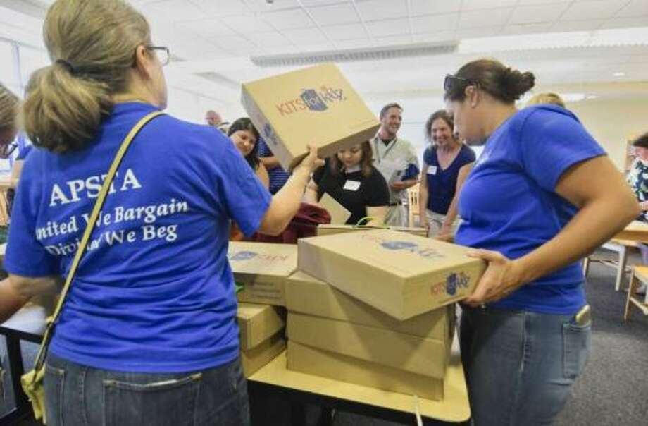Members of the Albany Public School Teachers Association hand out free book bags and school supplies to new teachers in the Albany School District on Monday, Aug. 27, 2018, in Albany, N.Y Photo: Paul Buckowski/Times Union