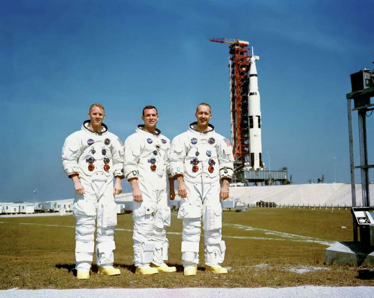 (23 Feb. 1969) --- These three astronauts are the prime crew of the Apollo 9 Earth-orbital space mission. From left are are Russell L. Schweickart, lunar module pilot; David R. Scott, command module pilot; and James A. McDivitt, commander. In the background is the Apollo 9 space vehicle on Pad A, Launch Complex 39, Kennedy Space Center.