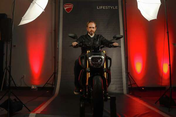 Ducati North America CEO Jason Chinnock with the Diavel 1260 motorcycle, Thursday, Feb. 21, 2019, in Houston.