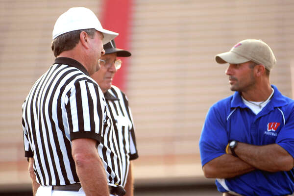 Westbury football coach Scott Joseph speaks to officials during warmups.