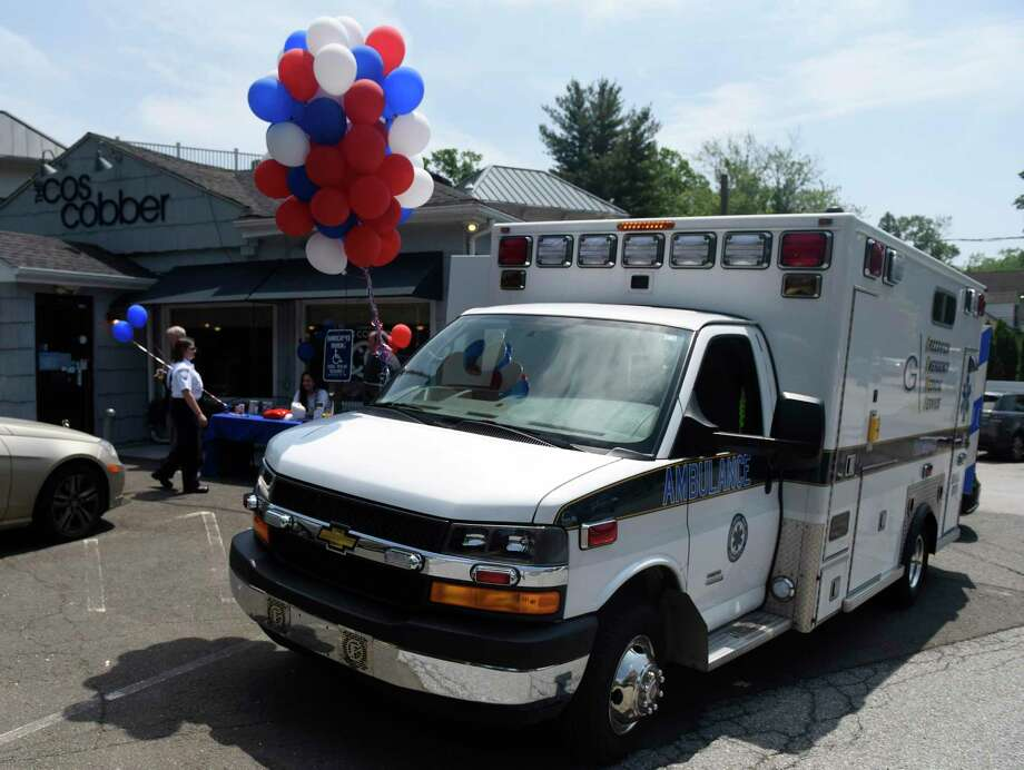 A GEMS ambulance is parked outside for the Greenwich Emergency Medical Service (GEMS) fundraiser at Caren's Cos Cobber in the Cos Cob section of Greenwich, Conn. Wednesday, May 30, 2018. Folks got a chance to tour an ambulance and meet GEMS employees with half the day's restaurant proceeds going to GEMS. Photo: Tyler Sizemore / Hearst Connecticut Media / Greenwich Time