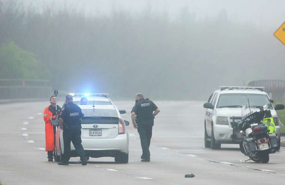 Harris County Sheriff's Office deputies investigate where a driver fatally struck a pedestrian on Beltway 8, just south of Philippine Street on Wednesday.