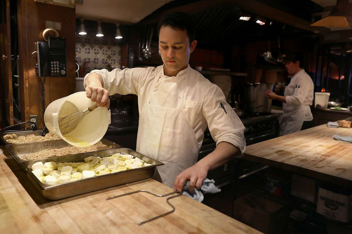 Baked goat cheese being prepared at Chez Panisse on Wednesday, Feb. 20, 2019, in Berkeley, Calif.