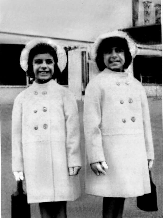 In 1964 the Passerelle sisters posed in their new Easter coats in an advertisement that ran in The Stamford Advocate for Frankel's, which used to be a department store on Atlantic Street. Danielle, 8, is on the left and Darlene, 7, on the right. Photo: Contributed Photo / Stamford Advocate Contributed