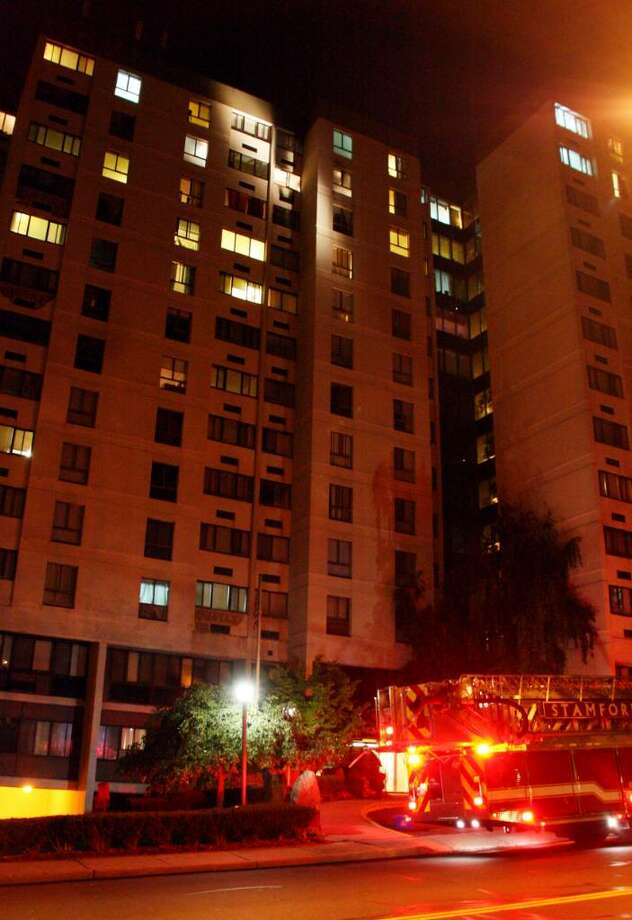 A two-alarm fire displaced 30 residents of a 160-unit high-rise apartment building at 60 Strawberry Hill Avenue Thursday night around 11 p.m.  Two residents were treated for smoke inhalation, and firefighters rescued four residents trapped inside apartments on the top floors. The majority of the residents evacuated the building before firefighters arrived because of the building's alarm system. Photo: Contributed Photo\Frank Blefari / Stamford Advocate Contributed