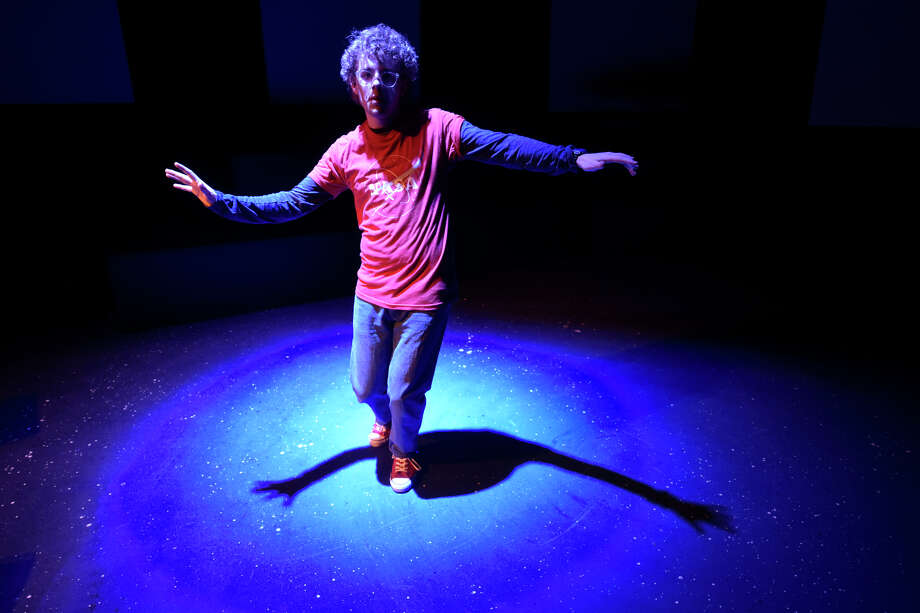 "Christopher (Chris Cheek) imagines that he is floating in space during rehearsal Feb. 26, 2019, for the upcoming Pickwick Players show titled ""The curious incident of the dog in the night-time"" which will be presented at Midland Community Theater March 1-23. James Durbin/Reporter-Telegram Photo: James Durbin / ? 2018 Midland Reporter-Telegram. All Rights Reserved."
