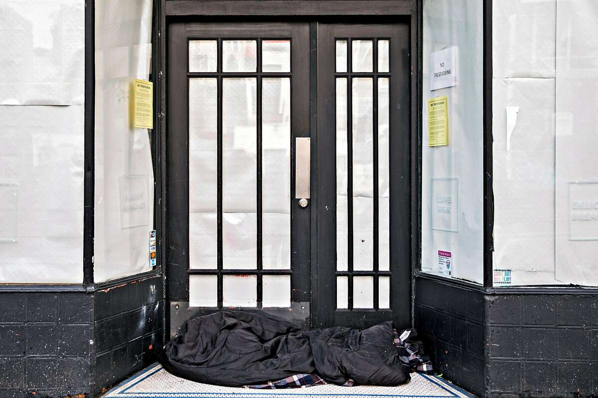 An empty sleeping bag is left in the doorway of a closed store along Market Street in San Francisco, Calif. Wednesday, Feb. 27, 2019.