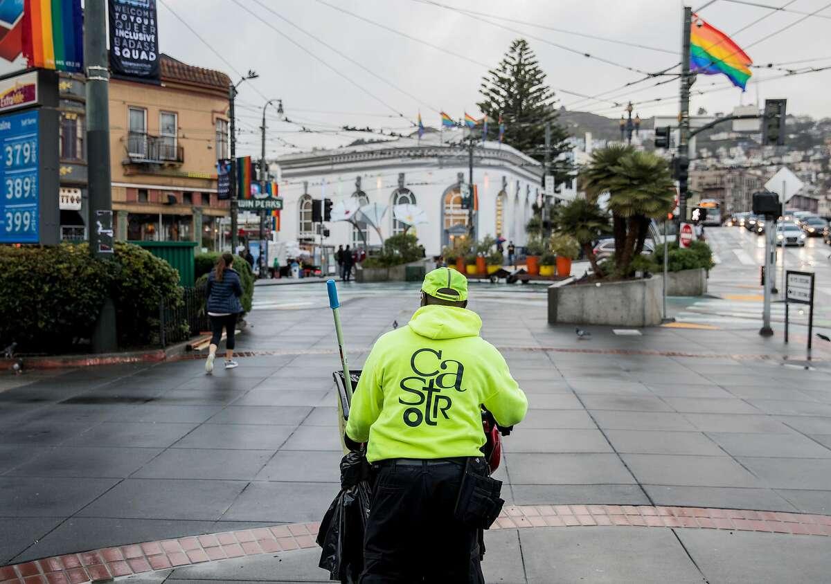 Castro Community Benefit District cleaning ambassador Derron Jones makes his way toward Castro Street along Market Street in San Francisco, Calif. Wednesday, Feb. 27, 2019.