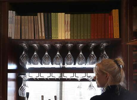 The back bar upstairs with the bookshelf displaying Chez Panisse cookbooks seen on Wednesday, Feb. 20, 2019, in Berkeley, Calif.