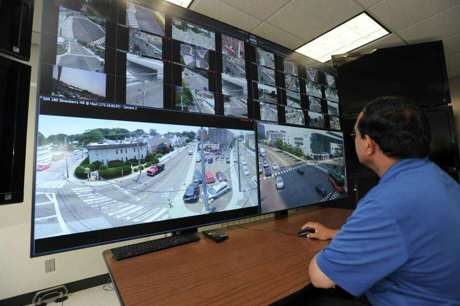 Signal engineer Veera Karukonda in the traffic operations center at the Stamford Government Center in July 2018. Photo: Michael Cummo / Hearst Connecticut Media / Stamford Advocate