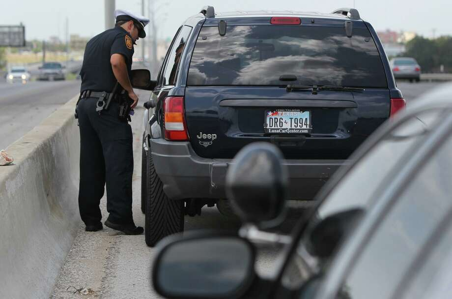 A San Antonio police traffic officer speaks with a driver in 2012 after he observed aggressive driving. A reader requests that police step up such efforts on expressways. Photo: Staff File Photo / John Davenport/San Antonio Expre