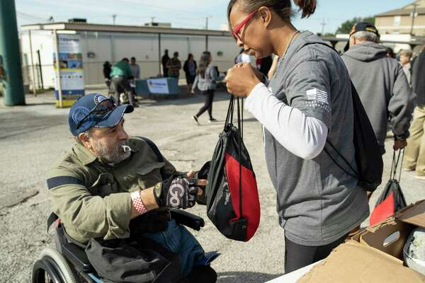 This was the scene last year when Robert Lopez, a Navy veteran from the Vietnam era, received a frozen turkey from volunteer Delores Rawls, an Army veteran. Be kind. Do good. Give thanks.