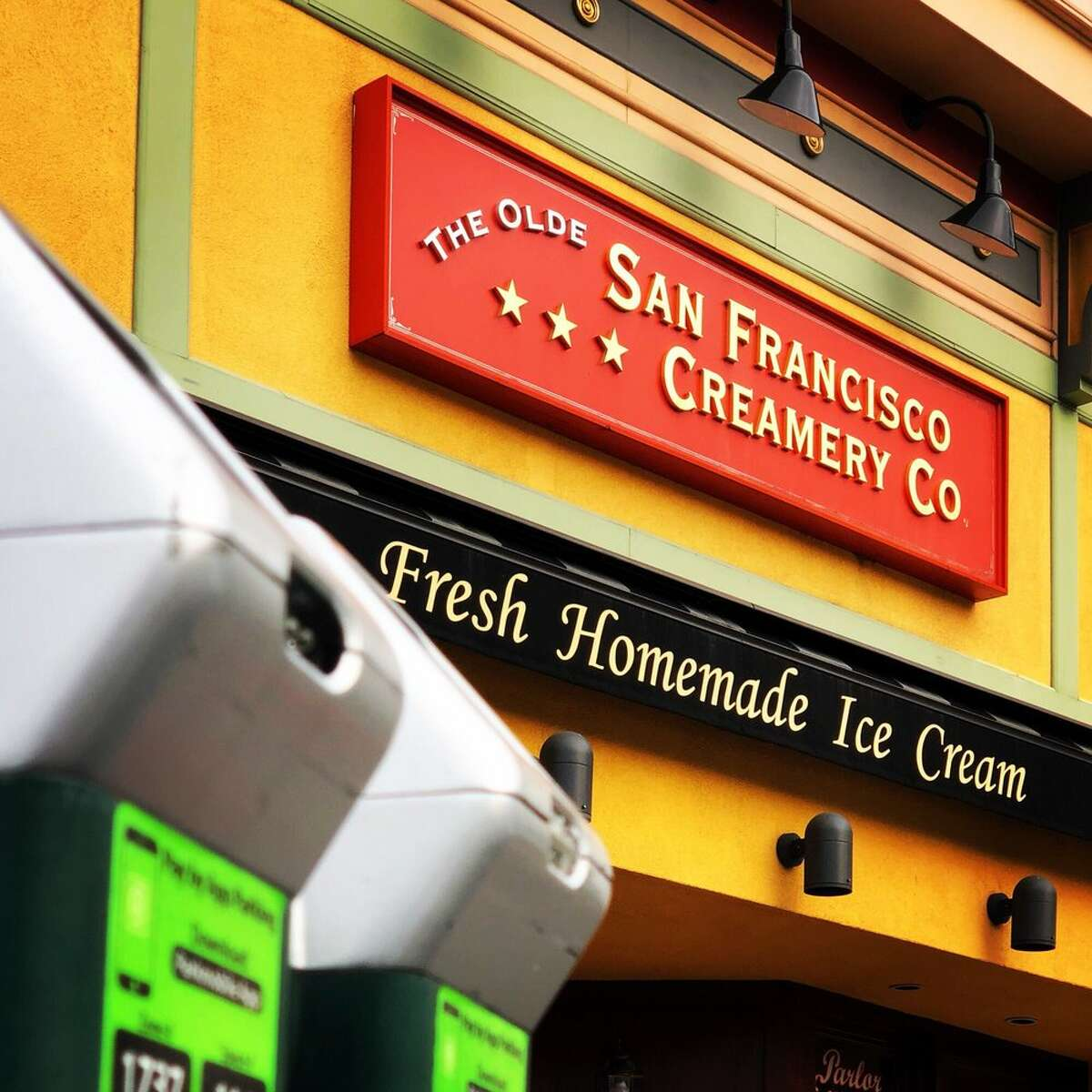 A sign in from of the San Francisco Creamery.