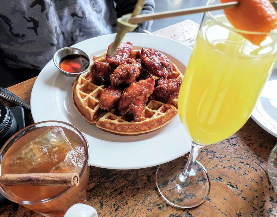 Fried chicken and waffle, classic mimosa, and the maple old fashioned for brunch at Harlan Publick in SoNo. Photo: Frank Whitman / For Hearst Connecticut Media / Norwalk Hour freelance