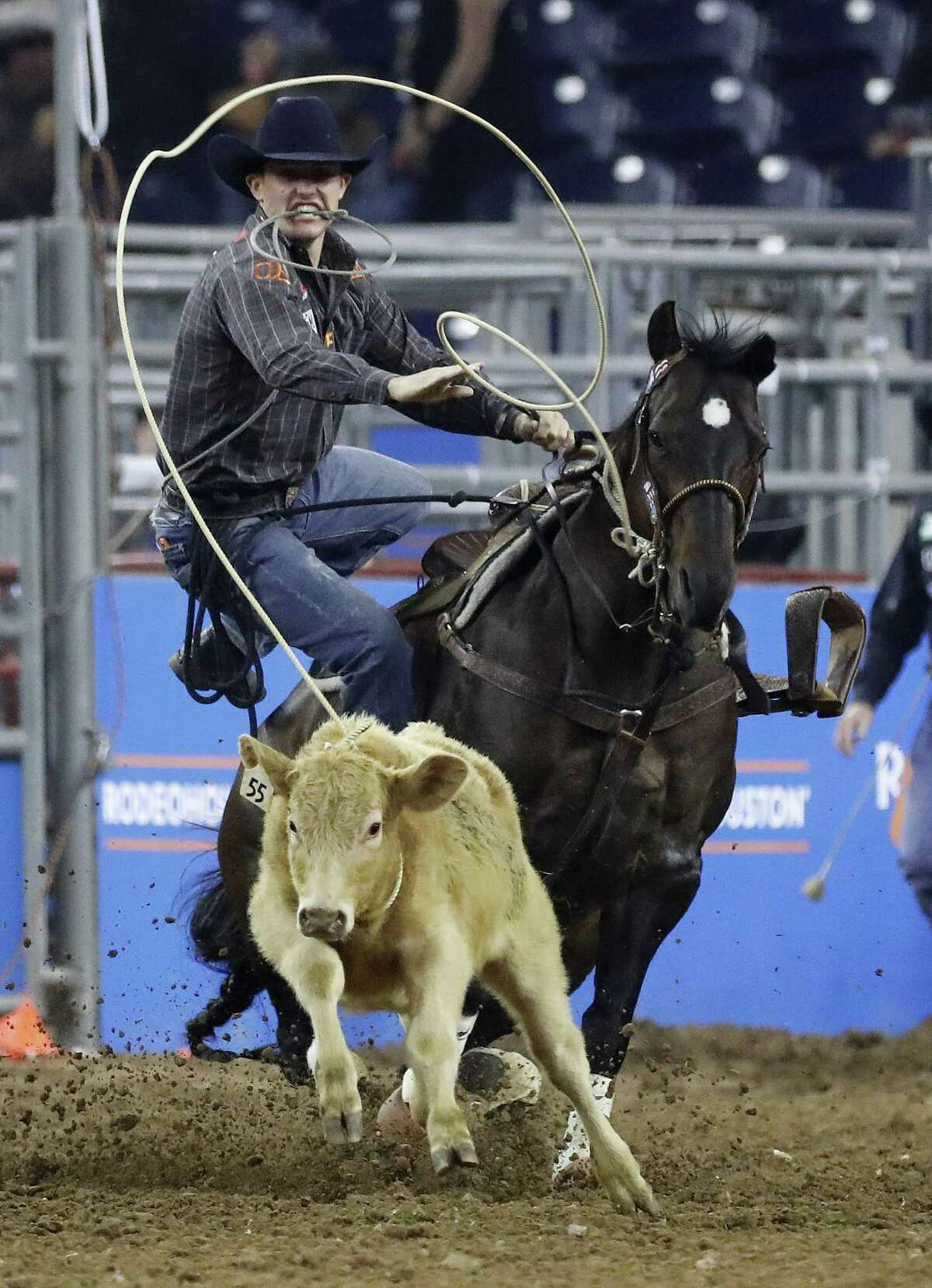 Tuf Cooper competes in the tie-down roping in round 1 of the Super Series I on Monday during the Houston Livestock Show and Rodeo at NRG Stadium.