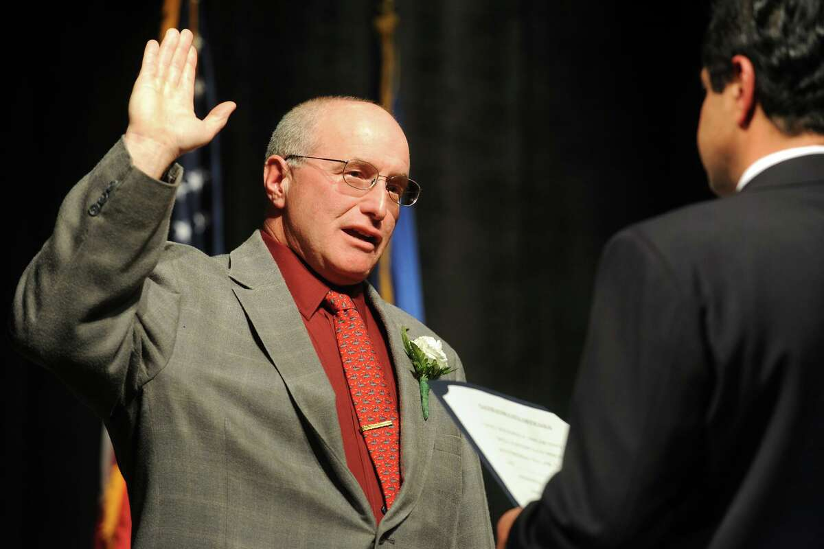 FILE PHOTO: Charles Stowe is sworn in as an Alderman for the City of Ansonia at Ansonia High School, in Ansonia, Conn., Dec. 2, 2013.