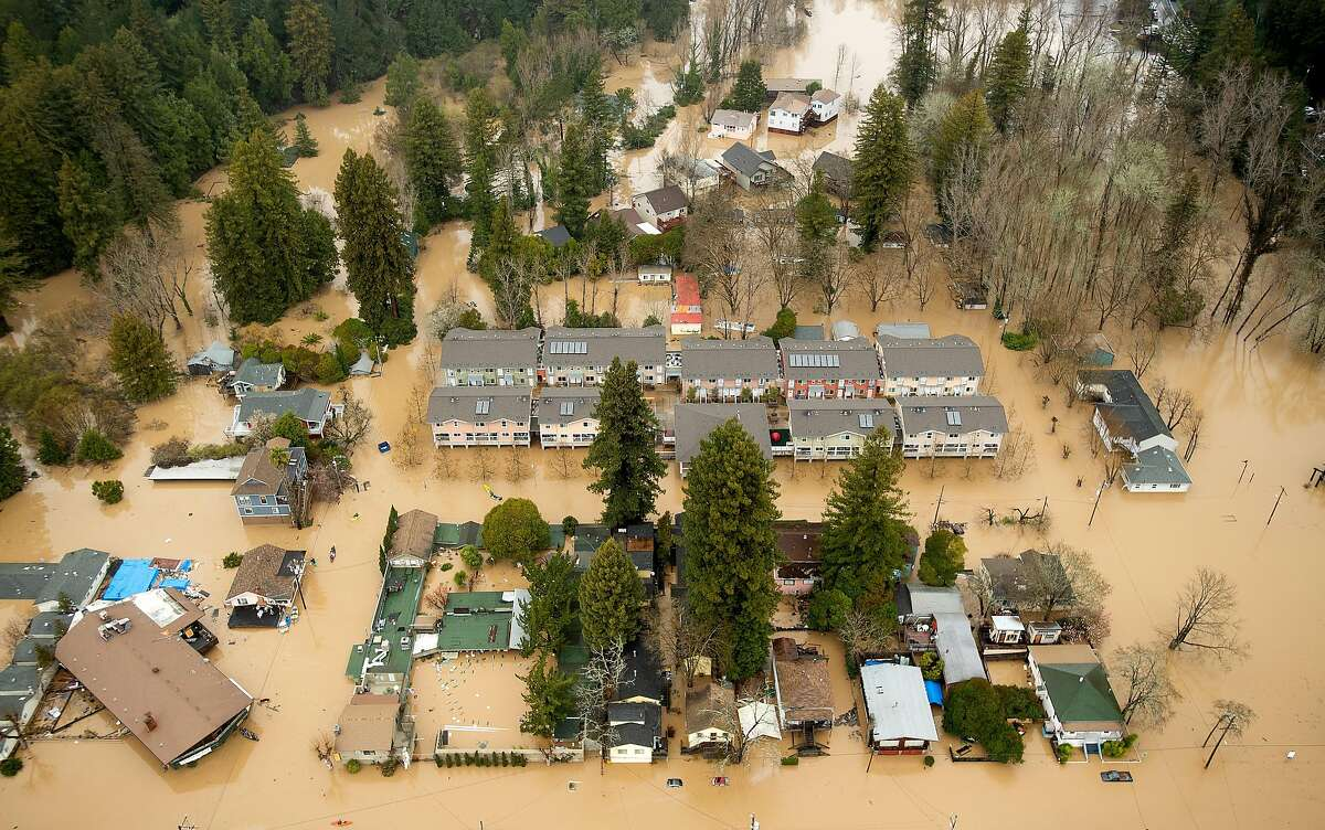 FILE - Floodwaters surround homes in Guerneville, Calif., as the Russian River overflows its banks in this Feb. 27, 2019 file photo. The historic flood occurred during atmospheric river, which, when combined with sea level rise, could leave large parts of the Bay Area and other coastal areas of Northern California vulnerable to extreme flooding throughout the rest of the century, according to a new study from the United States Geological Survey. Click through to see the different important sites around the Bay Area (like two of the region's three commercial airports) that are at particular risk for flooding in the near future due to sea level rise and the possibility of extreme weather events. Data taken from Our Coasts Our Future. >>>